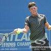 Austin Smith (USA) hits a forehand against Denis Kudla (USA) during a qualifying match.  Denis Kudla defeated Austin Smith in straight sets 6-4, 6-4 in the Sunday Qualifier at the Atlanta Tennis Championships at the Racquet Club of the South in Norcross, GA.