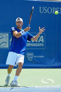 Tim Smyczek (USA) hits a forehand against Gabriel Townes (USA) during the qualifying rounds.  Tim Smyczek defeated Gabriel Townes in straight sets 6-4, 6-2 in the Sunday Qualifier at the Atlanta Tennis Championships at the Racquet Club of the South in Norcross, GA.