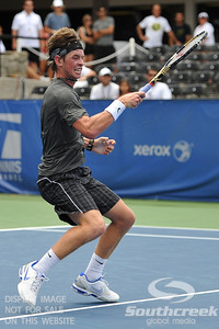 Austin Smith (USA) follows through against Denis Kudla (USA) during a qualifying match.  Denis Kudla defeated Austin Smith in straight sets 6-4, 6-4 in the Sunday Qualifier at the Atlanta Tennis Championships at the Racquet Club of the South in Norcross, GA.