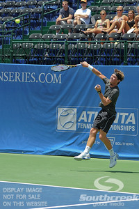 Austin Smith (USA) hits an overhead smash against Denis Kudla (USA) during a qualifying match.  Denis Kudla defeated Austin Smith in straight sets 6-4, 6-4 in the Sunday Qualifier at the Atlanta Tennis Championships at the Racquet Club of the South in Norcross, GA.