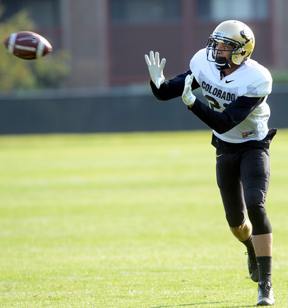 Jered Bell (21) works on a pass defense drill during the University of Colorado football team practice on Tuesday August 21 , 2012.<br /> For more photos go to www.buffzone. com<br /> Photo by Paul Aiken