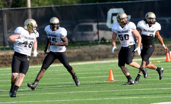 From left to right Clayton Jones (48) Lowell Williams (45) Scotty Jarvic (50) and K.T. Tu'umalo (42) run ball direction drills during the University of Colorado football team practice on Tuesday August 21 , 2012.<br /> For more photos go to www.buffzone. com<br /> Photo by Paul Aiken