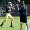 Alex Turbow (86) catches a pass  during the University of Colorado football team practice on Tuesday August 21 , 2012.<br /> For more photos go to www.buffzone. com<br /> Photo by Paul Aiken