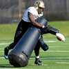 Juda Parker (56) knocks the ball loose during a drill during the University of Colorado football team practice on Tuesday August 21 , 2012.<br /> For more photos go to www.buffzone. com<br /> Photo by Paul Aiken