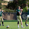From left to right quarterbacks Jordan Webb (4), Shane Dillon (7), and Connor Wood (5) throw practices tosses during the University of Colorado football team practice on Tuesday August 21 , 2012.<br /> For more photos go to www.buffzone. com<br /> Photo by Paul Aiken
