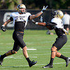 Isaac Archuleta (10) defends against Greg Henderson (20) during the University of Colorado football team practice on Tuesday August 21 , 2012.<br /> For more photos go to www.buffzone. com<br /> Photo by Paul Aiken