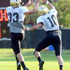 Isaac Archuleta (10) defends against Richard Yates (33) during the University of Colorado football team practice on Tuesday August 21 , 2012.<br /> For more photos go to www.buffzone. com<br /> Photo by Paul Aiken