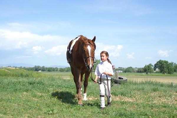 Abby riding horses as a kid