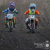 891 Marcus Hurtz from Omaha, chases down 14 Cohen Zarp from Bellevue in the 50cc Jr 4-6 class out at the Off Road Ranch Sunday morning. This was the last race of the year out at the Off Road Ranch. <br /> Photo by Aaron Beckman