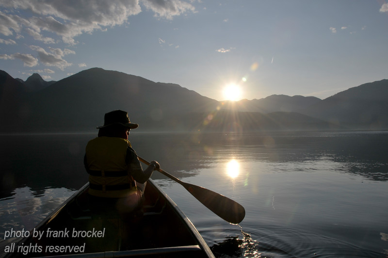 Canoeing on a hot quiet evening on Kootenay Lake