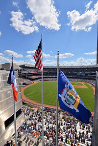 The flags fly above the left field bleachers.