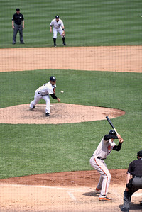 Yankees Pitcher Tanaka delivers to the plate.