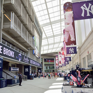 "The ""Great Hall"" featuring banners of past Yankees greats."