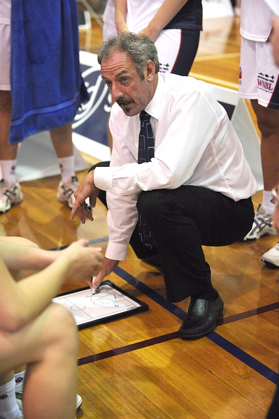 The AIS coach outlining the game plan, but with a minute to go, he would have needed the Flames to co-operate.