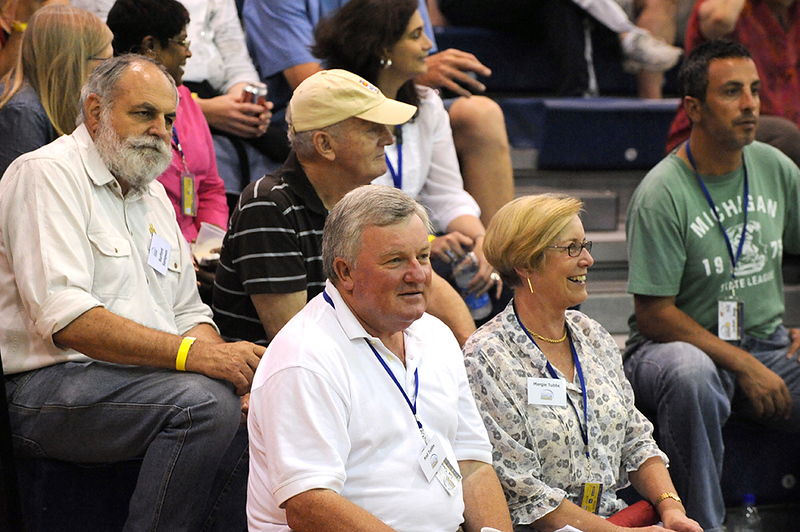 VIP's enjoying the battle on court before them.