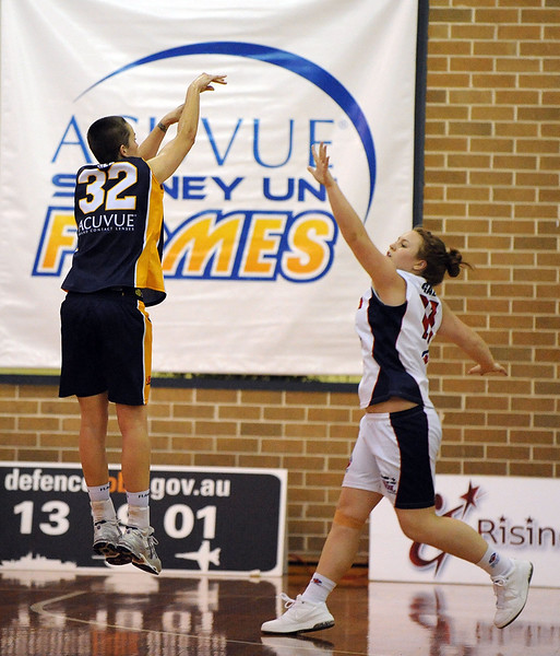 Kristen Veal hangs in the air as she gets the shot away.