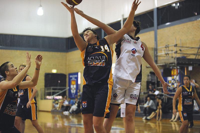 Natalie Porter working hard under the basket.