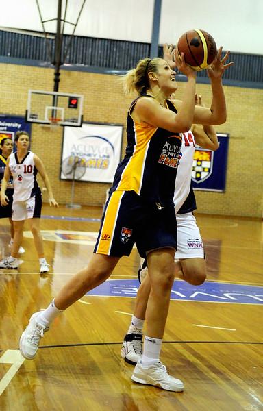 Rachel Herrick shrugs off the defense.