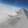 Alaskan peaks poke through the clouds as we near Anchorage.