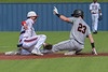 #23 Aledo centerfielder Max Belyeu appears to get tagged out as he attempts to steal second base.