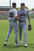 Aledo starting pitcher Tristan Thurman  gets a handshake from teammate #20 Keaton Laidley after a good first inning.