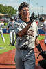 #21 Aledo IF/ P Adrian Guzman signals for someone to toss him a water bottle in between innings.