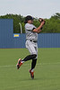 Aledo Third baseman #3  Hunter Rudel makes the stop on a bouncing ball then makes the throw to first for the out.