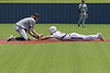 Aledo Shortstop #7 Sam Sisk gets the tag on #14  of the Justin Northwest Texans.