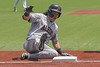 #11 Aledo catcher/pitcher Creed Willems slides safely into third after hitting a triple in the first game of a doubleheader.