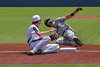 Aledo Right Fielder #1 Zach Harrison slides into third as the Justin NW third baseman is ready for the tag out.