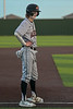 Aledo Shortstop #7 Sam Sisk looks towards the dugout after arriving safely at third base.
