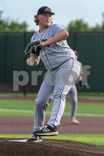 Aledo starting pitcher #18 Carter Shands winds up to throw.