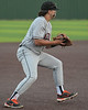 Aledo 3rd baseman #3 Hunter Rudel fields a blooper to third and prepares to make the throw to first for the out.