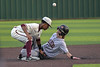 Aledo shortstop #7 Sam Sisk slides safely to second base as the ball flies over both player's head.