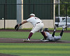 Aledo shortstop #7 Sam Sisk out runs the throw with a head-first slide into first base
