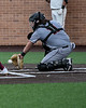 Aledo catcher #11 Creed Willems gets his glove on the ground to stop a low pitch from getting by him.