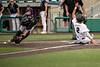 #2 Aledo designated hitter Parker Stegall slides into home to score the winning run just in front of the throw to the catcher for Abilene Wiley.