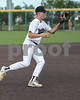 #4 Aledo third baseman Kevin Taylor fields a hit right to third base..