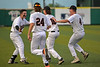 #1 Zach Harrison is mobbed by his teammates #24 Gabe Baker, #16 McKay Peterson and #4 Kevin Taylor after making the hit that drove in the game winning run.