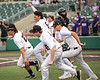Colton Campbell, Nolan Garcia and others rush onto the field after Zach Harrison's hit brought in the game winning run in extra innings.