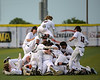 #2 Aledo's Parker Stegall gets some air as he joins the dog pile in left field after scoring the game winning run off a Zach Harrison hit.