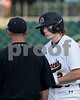 #2 Designated hitter Parker Stegall listens as Coach Barry talks strategy on his next at bat.