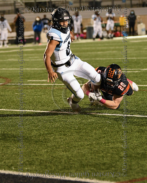 Aledo linebacker #20 Sam Foreman is able to hang on to one leg and make an open field tackle on Arlington Seguin quarterback #8 Xavier Gordon to keep him from scoring.