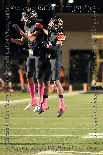 Aledo players with mad hops during a celebration of an Aledo Bearcat touchdown.