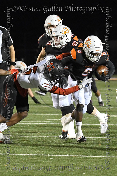 Aledo RB #6 DeMarco Roberts just misses the grasp of #5 Dallas Hillcrest LB Shannon Cruse.