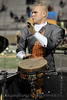 A percussionsit in the Aledo marching band playing the congo drum during the halftime performance.