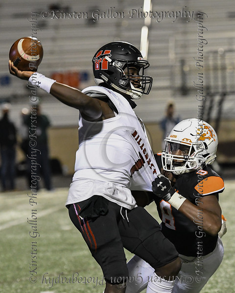 Aledo defensive end #8 Chris Wright in for the tackle as he gets a stronghold on #1 Dallas Hillcrest quarterback Carter Sido's jersey.
