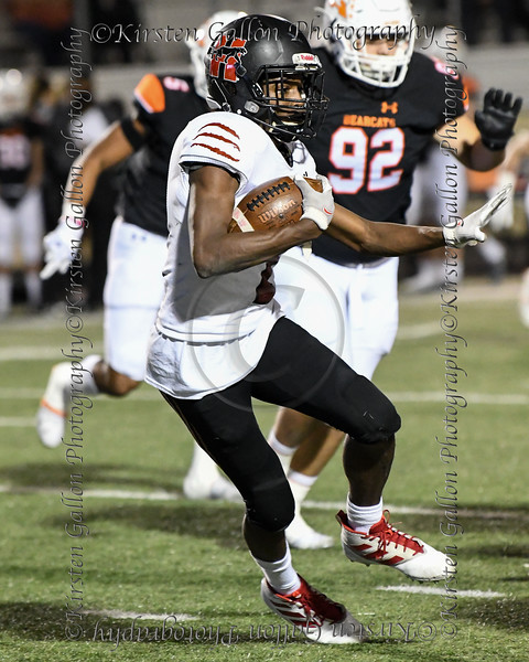 Dallas HIllcrest running back #2 Reggie Williams looks for room to run.