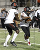 Dallas HIllcrest running back #2 Reggie Williams takes the handoff from quarterback #1 Carter Sido.