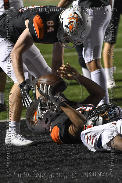 Aledo TE #84 Dylan Ward gives a hand up to #37 after he scored a late 4th quarter touchdown.